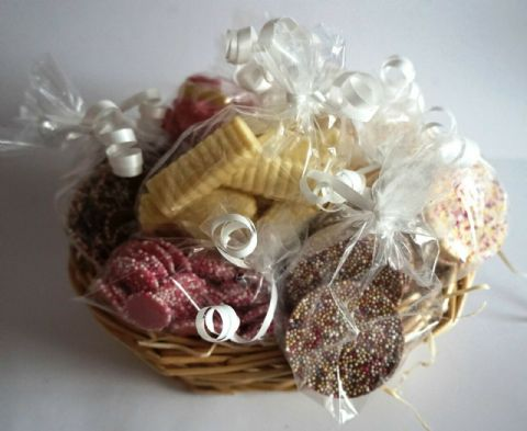 DOG BIRTHDAY BASKET WITH SPECIALTY DOG CHOCS GIFT WRAPPED IN A BEAUTIFUL BASKET